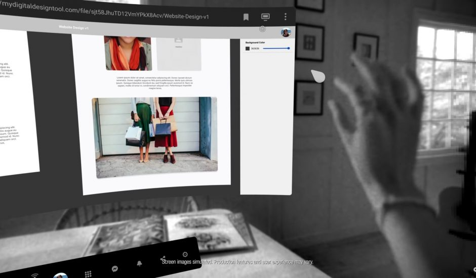 Une main sélectionne un élément sur son bureau virtuel Infinite Office
