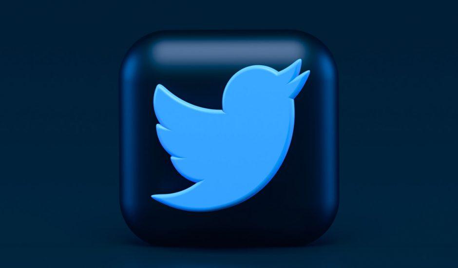 Le logo de Twitter en 3D sur un fond noir.
