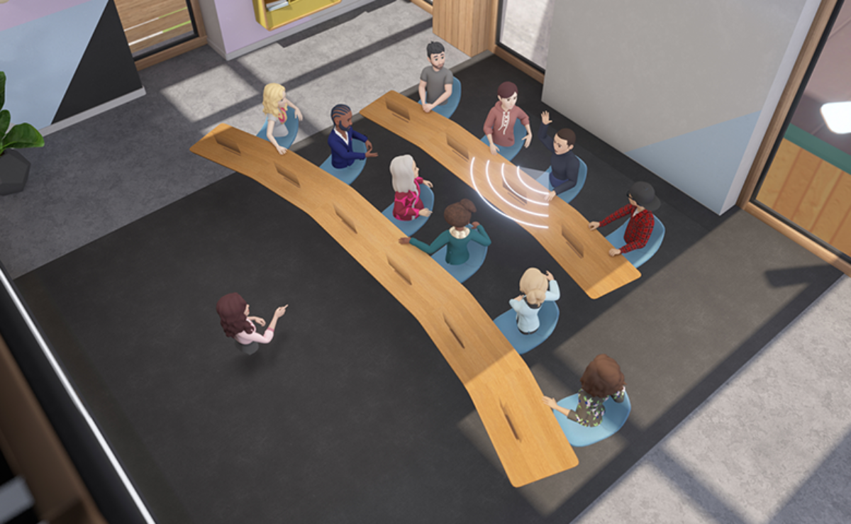 Représentation d'une salle de réunion virtuelle dans Facebook Horizon Workroom. Un interlocuteur lève la main pour s'exprimer et ses collègues se tourent vers lui pour l'écouter.